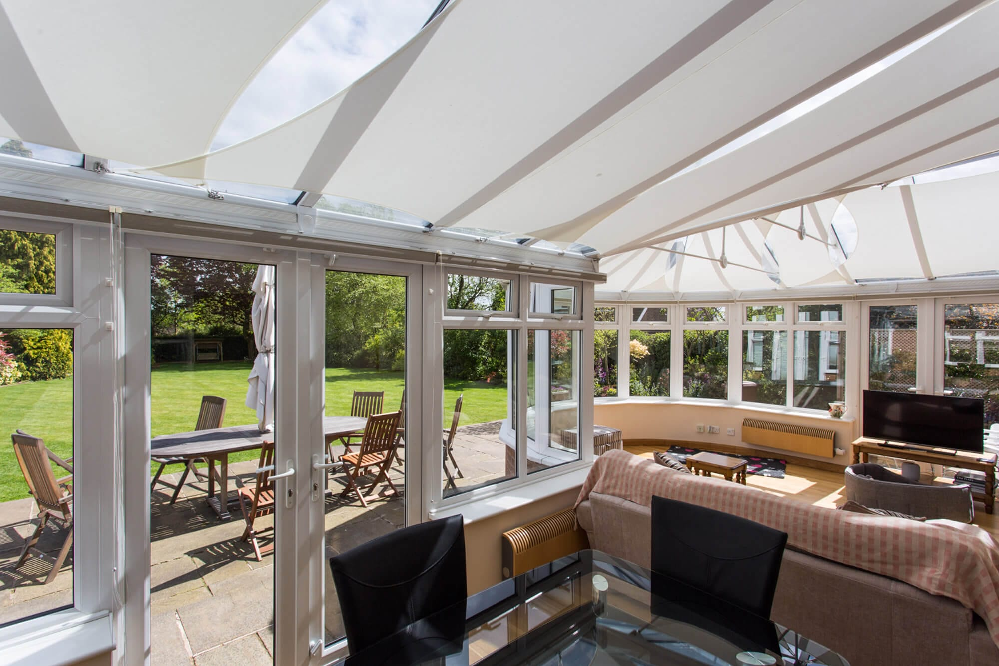 control heat and glare with modern conservatory roof blinds